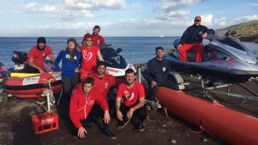 St Kilda surf lifesaver Simon Lewis and his team with the newly-purchased jet-ski and the Centifloat.