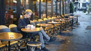 A man takes a seat at A la Bonne Biere cafe in Paris during its reopening on Friday, for the first time since the attacks of November 13, in which five people were killed on its premises.
