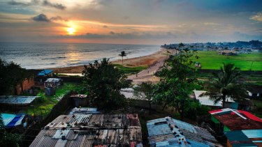 A view of the Atlantic Ocean is seen from the roof of a home in the Capitol Hill area of Monrovia, Liberia