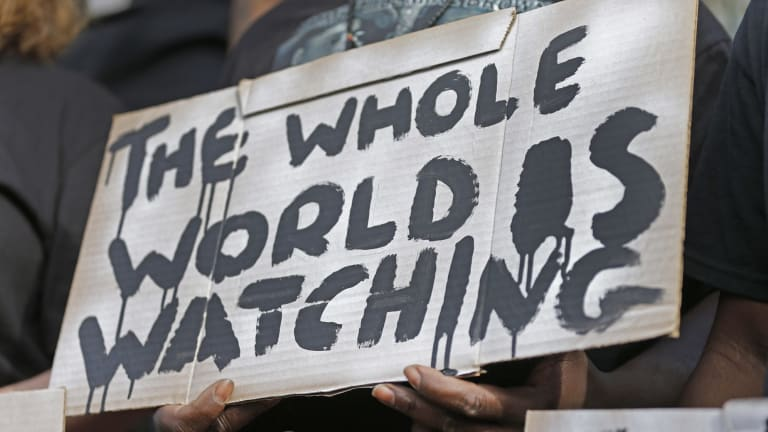 A man holds a sign during a protest for the shooting death of Walter Scott in South Carolina on Wednesday.