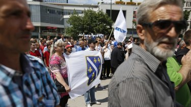 Bosnians wave the wartime Bosnian Army flag in Sarajevo earlier this month, protesting the arrest of Naser Oric.