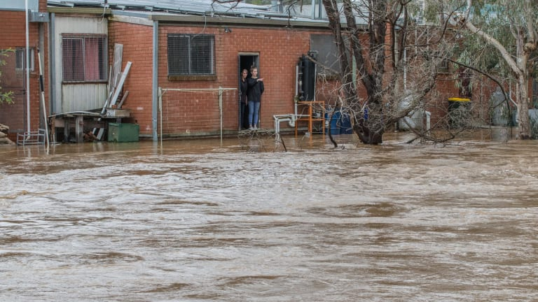 Residents of Myrtleford watch the rising floodwaters.