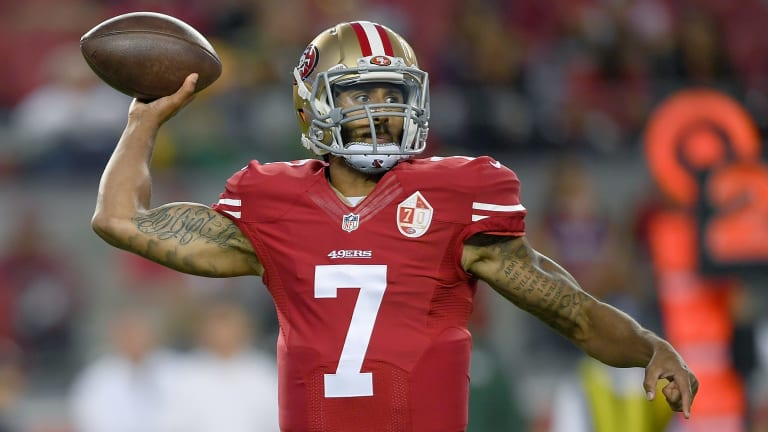 Protest: San Francisco 49ers quarterback Colin Kaepernick did not stand for the US national anthem.