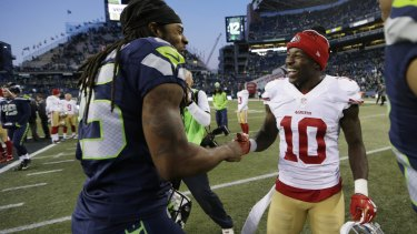 Friendly rivals: Seattle cornerback Richard Sherman greets San Francisco wide receiver Bruce Ellington after the Seahawks defeated the 49ers 29-13 in Seattle.