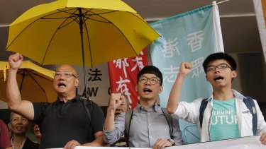 From left, lawmaker Albert Chan and pro-democracy leaders Nathan Law and Joshua Wong last year after Wong was acquitted of obstructing police at a 2014 protest.