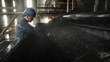 A worker monitors the coal washing process at a mine in Datong, China, in May 2014.