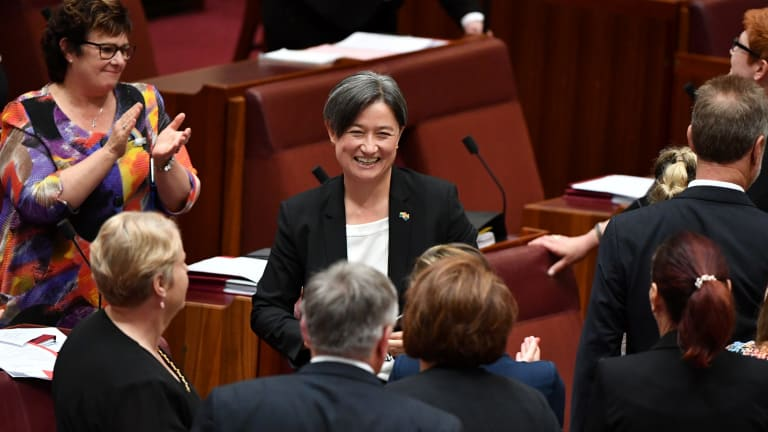 Senators celebrate the result with Labor's Penny Wong.