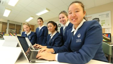 Students (from left) Sarah Vandebberg, Georgia Grasso, Angie Liu, Erika Dudkin and Alice Shang at Tara Anglican girls school learn to code.