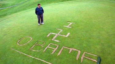 Lakeville Country Club owner Gary Mosca looks down at a message carved into the 18th green on October 13, 2009, in Lakeville, Massachusetts.
