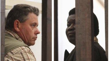 Zimbabwean safari operator Honest Ndlovu, right, and fellow countryman and hunter Theo Bronkhorst waiting to appear in Hwange magistrates court.
