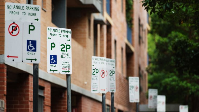 Motorists who use a disabled parking space without a permit can be fined $541 and a demerit point in Sydney compared to $US180 ($234.71) in New York City.