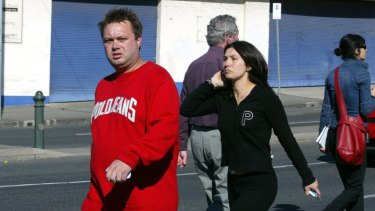 Ms Williams arrives with Carl Williams at the scene of a gangland murder in 2004.