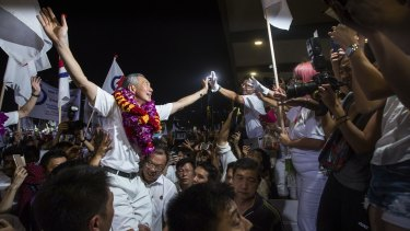 Lee Hsien Loong, Singapore's prime minister and leader of the People's Action Party (PAP), celebrates his party's win with supporters in Singapore on Saturday.