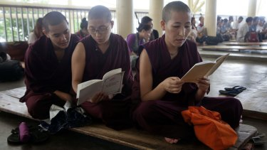 Exiled Tibetan Buddhist nuns in India pray to remember Tibetan lama Tenzin Delek Rinpoche.