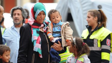 Migrant and refugees arriving in Germany on Tuesday.