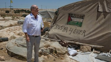 Irish author Colm Toibin visits what remains of the Palestinian village of Susiya in the Israeli-occupied West Bank in July.