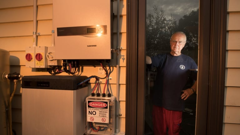 Bill Childs at home with his solar battery.