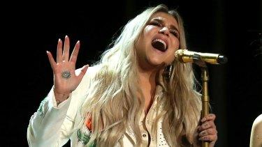 Kesha performs Praying at the Grammy Awards on Monday.