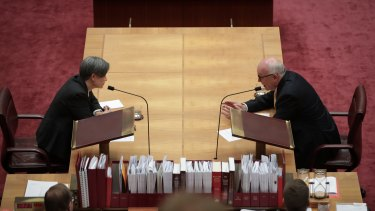Leader of the Opposition in the Senate, Penny Wong, and Attorney-General George Brandis in discussion in the Senate on Thursday.