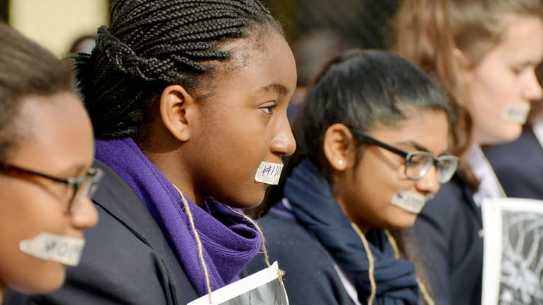 Students taped their mouths to protest the fact that asylum seekers don't have a voice.