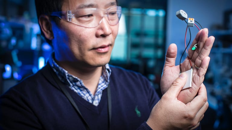 Jun Chen demonstrates wearable tech at the Australian Institute for Innovative Materials Intelligent Polymer Research Institute.