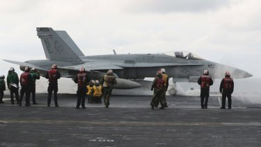 An F/A-18 fighter prepares to take off from the deck of the aircraft carrier USS Carl Vinson at an unidentified location in the international waters, east of the Korean Peninsula.