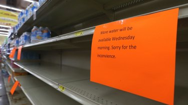 A shelf normally containing packaged water is empty at a Piggly Wiggly store in Panama, Florida, on Tuesday.