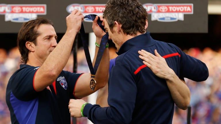 Beveridge presents Murphy with his medal.