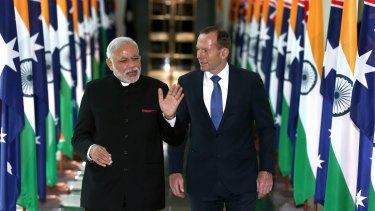 Indian Prime Minister Narendra Modi talks to Prime Minister Tony Abbott during his visit to Australia in November 2014.