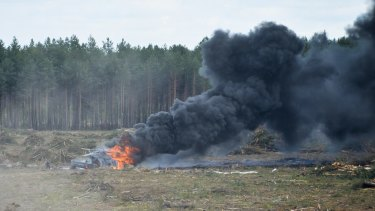 The Russian military helicopter burns after crashing.