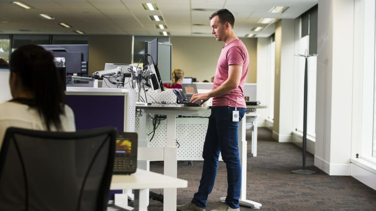 Standing desks may not be the answer.
