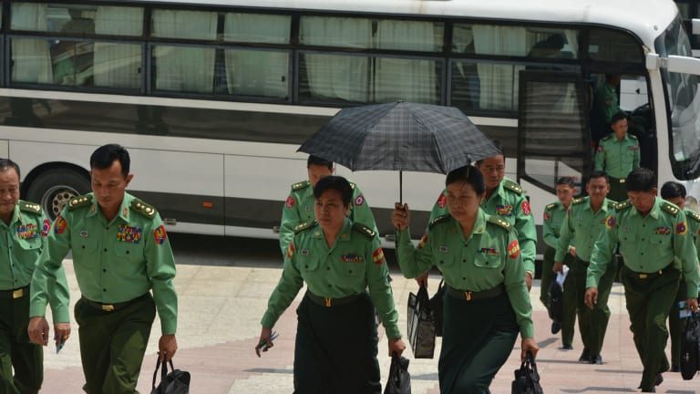 Appointed lawmakers who represent Myanmar's military arrive for a parliamentary session in Naypyitaw on Monday.