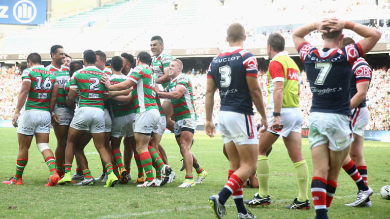 Jubilation: The Rabbitohs celebrate with Hymel Hunt after he scored a try during the round one NRL match between the Sydney Roosters and South Sydney at Allianz Stadium.