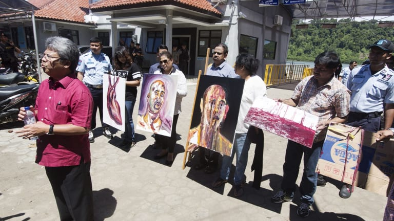 Paintings by Myuran Sukumaran, signed by all nine awaiting execution, are displayed by Sukumaran's family at Wijaya Pura in Cilacap on the day of the execution.