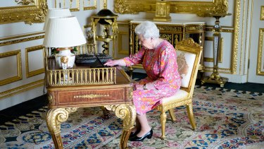 The Queen at her desk in Windsor Castle.