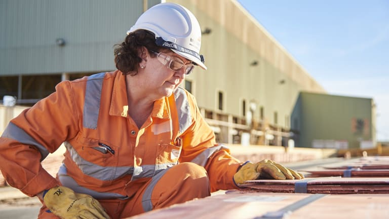 Olympic Dam asset president Jacqui McGill inspects some of copper cathode produced at the famous South Australian mine.