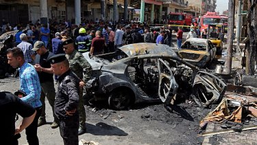 The site of one of the deadly bomb attacks in Baghdad on Monday.