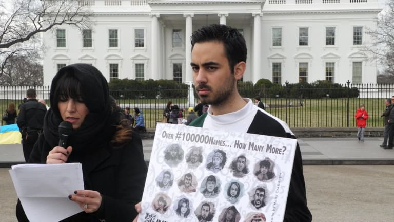 Lina Sergie Attar, left, with Kenan Rahmani, one of the co-founders of How Many More?, spent three days reading the names of Syrian victims outside the White House in Washington last year.