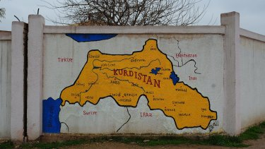 Map of Kurdistan hand-painted on a wall in the main city of Qamishli, in Rojava, north-eastern Syria.