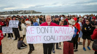 Narayan Van de Graaf from Elizabeth Bay woke up at 3am inspired to make a banner and join 1500 protesters on Bondi Beach.
