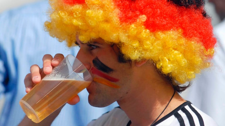 Level-headed: A German fan enjoys a beer at the football.