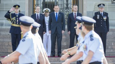 [L-R]: Chief of the Defence Force, Air Chief Marshal Mark Binskin, salutes as Opposition Leader Bill Shorten, Prime Minister Tony Abbott, ACT Chief Minister Andrew Barr and Australian Federal Police Commissioner Mark Colvin receive the parade on Saturday.