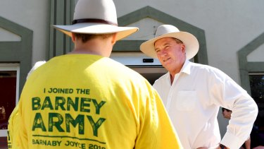 Former deputy PM Barnaby Joyce with campaign supporters on Tuesday.