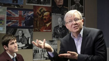 Kevin Rudd spoke to students at a school with posters of Hitler and Mussolini on the wall.