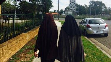 The sisters of terrorism accused Omarjan Azari in Guildford.