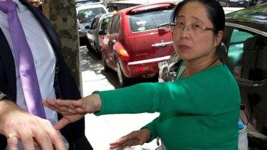 Jian Qing Xu leaves VCAT at an earlier hearing.