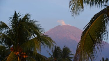 Steam rises from Mount Agung which has been threatening threatening to erupt for a week.