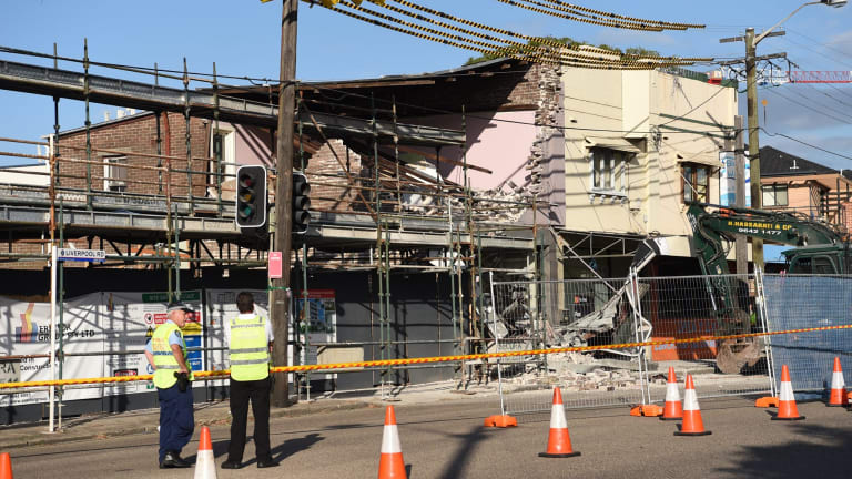 Authorities have closed Liverpool Road after the building partially collapsed.