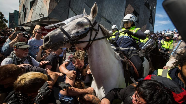Protesters clash with Reclaim Australia protesters at Federation Square under a huge police presence.