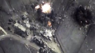 This image from the Russian Defence Ministry shows a Russian air force bomb hitting a target in Syria.